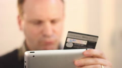Buying online with iPad using Credit card Stock Footage