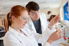Students working in chemistry lab Stock Photos