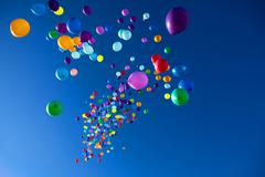 Colorful Balloons flying in the sky party Stock Photos