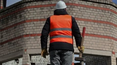 Worker with sledgehammer near building Stock Footage