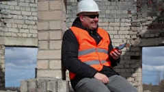 Civil engineer using tablet PC and start laughing Stock Footage