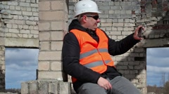 Civil engineer sitting and take pictures on tablet PC Stock Footage