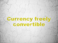 Money concept: Currency freely Convertible on wall background - stock illustration