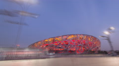 Timelapse/Hyperlapse. The Bird's Nest National Stadium at Night. Beijing, China. - stock footage