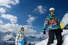 Snowboarders on snowy mountaintop - stock photo
