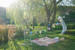Picnic blanket and bunting outdoors Stock Photos