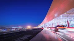 Timelapse. Airport Traffic Outside of Terminal at Night. Beijing, China. Stock Footage