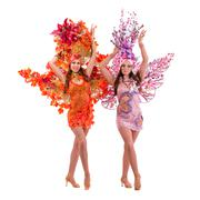 Two carnival dancer women dancing against isolated white Stock Photos