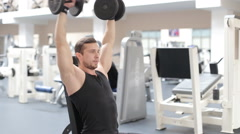 Man bodybuilder execute exercise with dumbbells in gym. Stock Footage