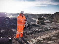 Ecologist monitoring sound in surface coal mine Stock Photos