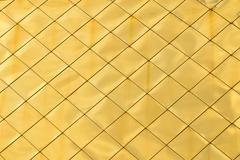 Golden metal panels texture background - stock photo