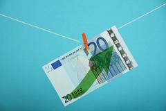 Euro currency growth illustrated over blue - stock photo