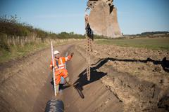 Digging drainage channel at surface coal mine restoration Stock Photos