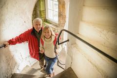 Couple explore Bolton Castle, a 14th century Grade I listed building and a Stock Photos