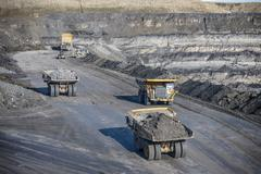 Dumpers containing rocks at surface coal mine, high angle - stock photo