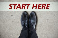 Composite image of businessmans feet in black brogues - stock photo