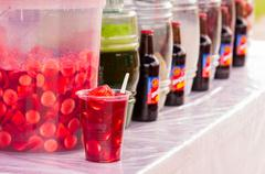 Various beverages on market, traditional come y bebe on plastic glass - stock photo