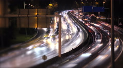Traffic lights in a busy city at night. Traffic of a big city. Stock Footage