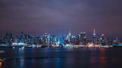 Timelapse. New York City Night Skyline Reflected In Water, Manhattan, USA. - stock footage