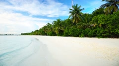 Tropical island with sandy beach with palm trees and tourquise clear water Stock Footage