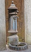 Old rusted  public water tap - stock photo
