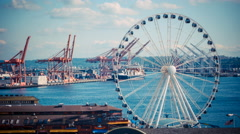 Timelapse of Seattle Great Wheel by Elliot Bay with Containers and Ships. Stock Footage