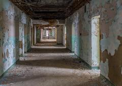Long corridor inside Trans-Allegheny Lunatic Asylum - stock photo