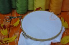The stylized photo in orange colors of objects for needlework - stock photo