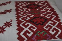 Cross stitch on linen, macro plan - stock photo