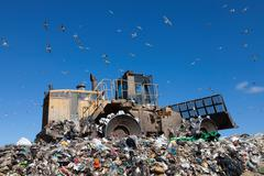 Machinery working on waste in landfill Stock Photos