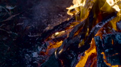 Outdoor wood campfire burring brightly with embers - stock footage