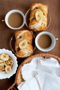 Baked pastries with banana and coffee Stock Photos