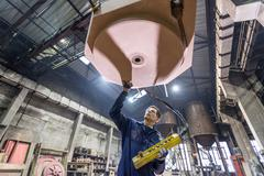 Worker inspecting sand mould in foundry Stock Photos
