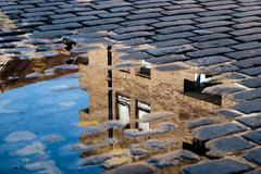 Reflection of House in Puddle Stock Photos