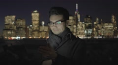 portrait shot of handsome asian man browsing the web on tablet pc - stock footage