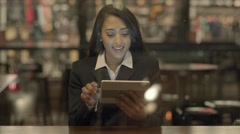 portrait of african american women using tablet computer searching the internet  - stock footage