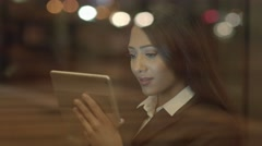 Attractive black business women networking with social media on tablet computer Stock Footage