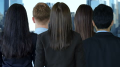 multi ethnic group of young professionals standing together looking at camera - stock footage