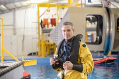 Portrait of offshore oil worker taking part in survival training in pool Stock Photos