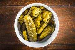 Bowl of pickles and chili pepper slices Stock Photos