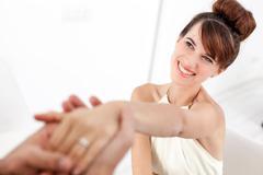 Man admiring fiances engagement ring Kuvituskuvat
