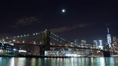 The Moon Setting over the Brooklyn Bridge and the Manhattan Skyline Stock Footage