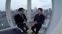 business meeting of young start up entrepreneurs in modern high rise office - stock footage