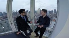 Business meeting of young start up entrepreneurs in modern high rise office Stock Footage