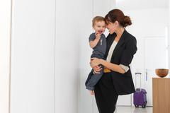 Mother returning from business trip Stock Photos