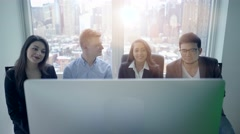 diverse multi ethnic group of young business people looking at computer screen - stock footage