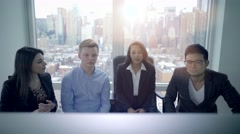 Teamwork of multi ethnic group analyzing together business strategy in office  Stock Footage