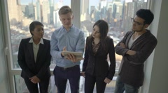 young diverse multi ethnic group of business professionals talking together - stock footage