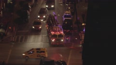 FDNY fire department truck getting emergency call in midtown manhattan at night Stock Footage