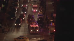 FDNY fire department truck getting emergency call in midtown manhattan at night - stock footage